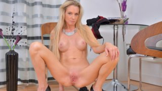 Sexy blonde milf fucks her tight snatch Preview Image