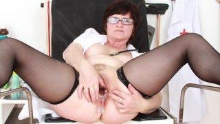 Brunette practical nurse examining her vagina Preview Image