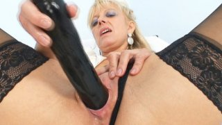 Old blonde milf stuffing pussy with huge dildo Preview Image