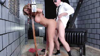Richelle Ryan getting pounded doggy style in a pillory Preview Image