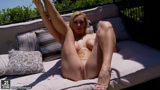 Cocky_Tanya_Tate_masturbates_while_relaxing_outside Preview Image