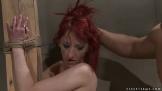 Pretty slender redhead girl Krisztin got tied up to the column by her boyfriend and getting hardly fucked by him. Preview Image