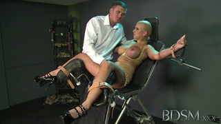 BDSM XXX Master straps submissive girl to a gyno chair Preview Image