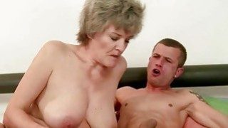 Busty granny enjoying sex with handsome_young man Preview Image