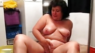OmaFotze BBW mature cleans floor and masturbating Preview Image