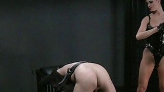 Busty mistress spanking male sub in dungeon Preview Image
