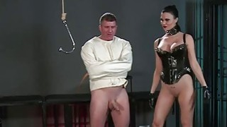 Slave in straitjacket in femdom in dungeon Preview Image