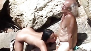 Kinky old fart and slutty brunette fucking on the Preview Image