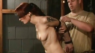 Busty redhead is tied to a cross for bondage sex Preview Image