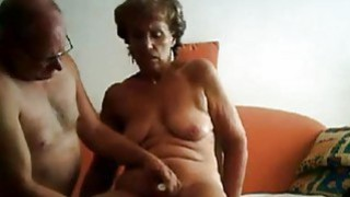 Real mature couple having sex on home sofa Preview Image