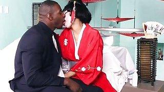 Petite Asian geisha takes on a huge black anaconda Preview Image