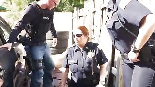 Outdoor interracial threesome with two busty female cops and big cocked stud Preview Image