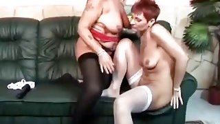 Horny lesbian grannies dildo fucking on couch Preview Image