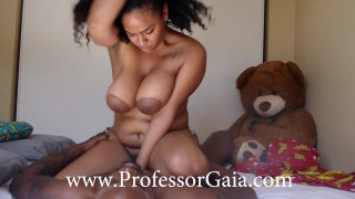 Curvy ebony babe with big jugs bounces on black monster Preview Image