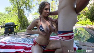 Busty American slut in bikini services a hard cock outdoors Preview Image
