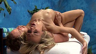 Oiled blonde fucks on a massage table Preview Image