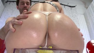 Glittering butt of Holly West gets plugged with a dildo and licked by James Deen Preview Image