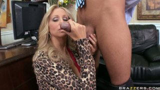 Vamp slut Julia Ann gives a tremendous blowjob to Keiran Lee in the office Preview Image