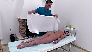 Oily brunette teased during massage Preview Image