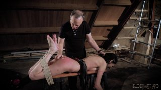 Submissive brunette in suspension bondage gets whi Preview Image