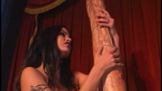 Gigantic two foot long dildo destroys hot brunette's pussy Preview Image