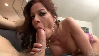 Mature busty bitch Kora Cummings sucks bowed dick on her knees Preview Image
