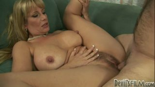 Busty blonde mom Olivia Parrish rides dick with her hairy cunt Preview Image