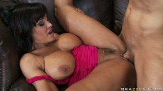 Voracious busty brunette Lisa Ann has a sexy time on the couch Preview Image