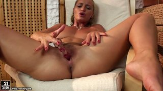 Raunchy blonde slut Kathia Nobili plays with her cherry rubbing it with a dildo Preview Image