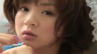 Elegant Japanese angel Aki Hoshino eats ice cream in the park Preview Image