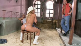 Fabulous cowgirl Nikky Thorne is on her knees sucking two guys Preview Image