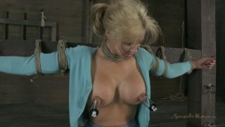 Tanned busty blondie Phoenix Marie is attached to the bar and sucks a cock Preview Image