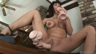 Busty Carrie Ann enjoys gigantic adult toy Preview Image