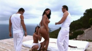 Top notch brunette sexpot Angel Dark is ready for a foursome Preview Image