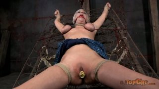 Vulnerable blondie Cherry Torn is gagged and crucified in the_shed Preview Image