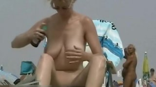 Superb voyeur beach video of a trimmed pussy tanning Preview Image