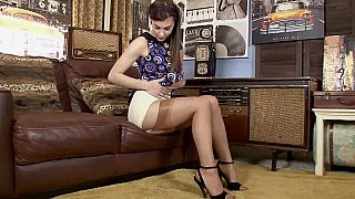 Brunette babe takes her vintage clothes off Preview Image