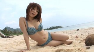 Really cute Jap girlie Mayu Nozomi walks on the beach in bikini Preview Image