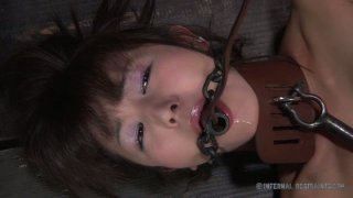 Petite brunette Asian Marica Hase gets her tender tootsies caned Preview Image