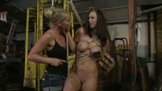 Kathia Nobili ties up bosomy brunette Zyna Babe and spanks her Preview Image