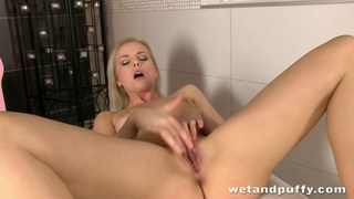 Sexy blonde girl pleasing her smooth cherry Preview Image