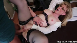 Mature teacher Nina Hartley spreads her legs in front of her young student Xander Corvus Preview Image