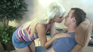 Horny blonde Coco Velvett gives man a blowjob break from his work Preview Image