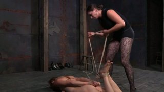 Vulnerable blond head Tracy gets hogtied and humiliated on the floor Preview Image