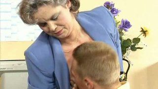 Volutuous grey haired granny Kelly fucks her young boy in the office Preview Image