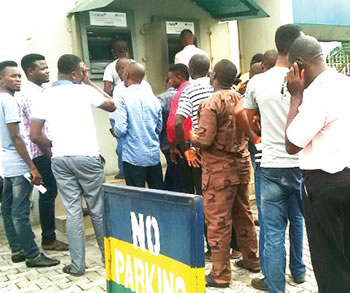 Yuletide: Customers form long queues at banks' ATM points - Punch Newspapers