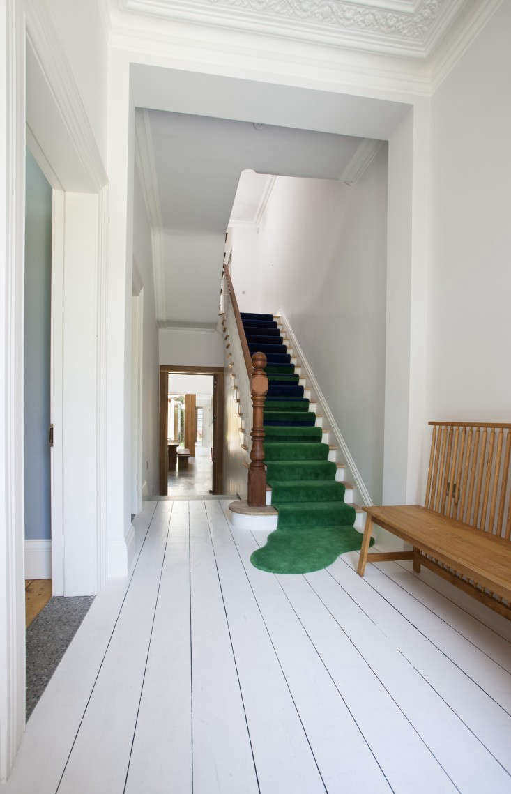 A Victorian Transformation Dublin Style Remodelista | Dark Carpet On Stairs | Gray | Monochrome | Wall | Modern | Metal Bar On Stair