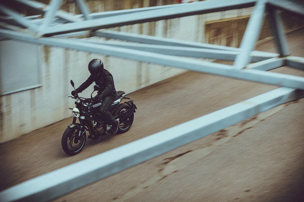 Rider a Svartpilen 125 on a bridge