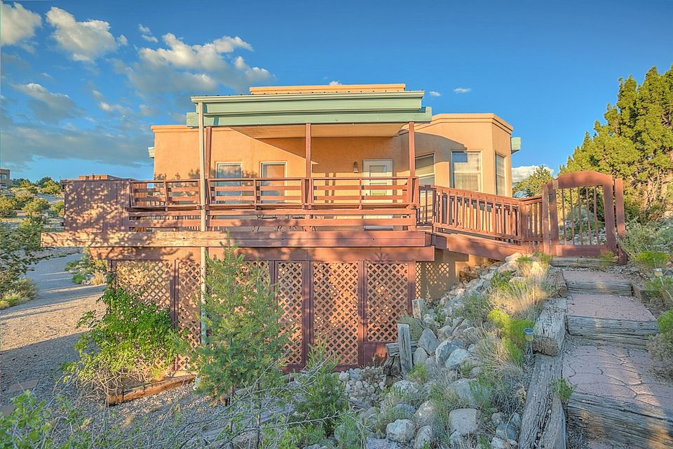 Beautiful views of Sandias and Cabezon Peak. 4th BR downstairs w/full bath & private entrance. Addt'l 1000 sf heated adobe workshop w/commercial-type exhaust fans-- perfect for auto restoration, woodworking, etc. Covered deck on west side & flagstone patio w/privacy wall-- access from master BR on S side. New carpet. New kitchen appliances. Evap cooling, private well, central elec heat & pellet stove. Office area w/built-in computer desk/bookcase. Circular driveway for convenient access to main level.  NEW SEPTIC; GARAGE DOOR; ALL INSPECTIONS COMPLETED!! READY TO OCCUPY..
