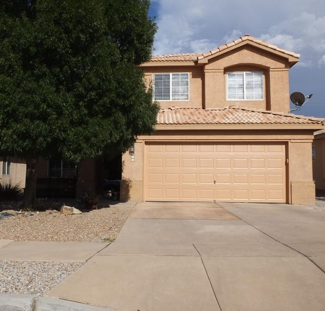 This wonderful two story home is in a  gated community. It has lots of room with two living areas and 4 bedrooms! Enjoy the backyard landscaped with plants, grass, comes with views of the Sandia Mountains.